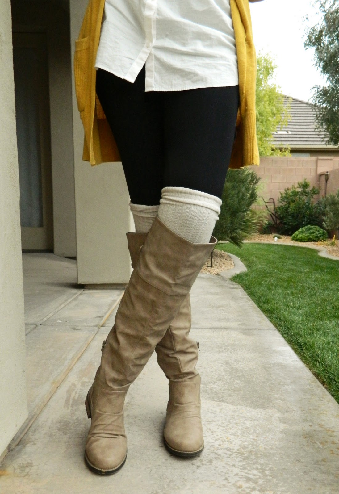 tan boots, white leg warmers