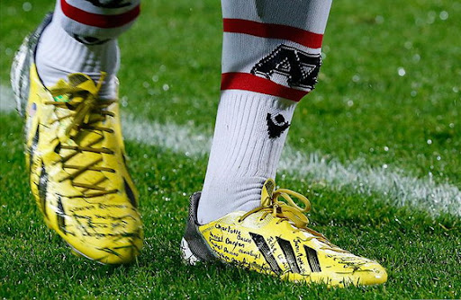 Jozy Altidore wears names of Sandy shooting victims on cleats