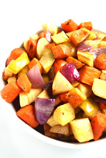 Roasted Root Vegetables with Spicy Balsamic Drizzle is flavorful and a simple side dish loaded with your favorite fall produce including sweet potatoes, parsnips, carrots, onions, pears and apples! www.nutritionistreviews.com