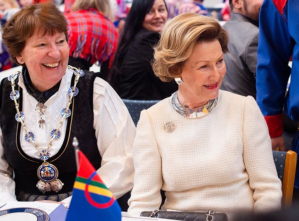 Sami people. The day is official flag-flying day. Queen Sonja Prada dress, gold necklace, diamond earrings