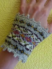 http://www.ravelry.com/patterns/library/fair-isle-wrist-warmers-2