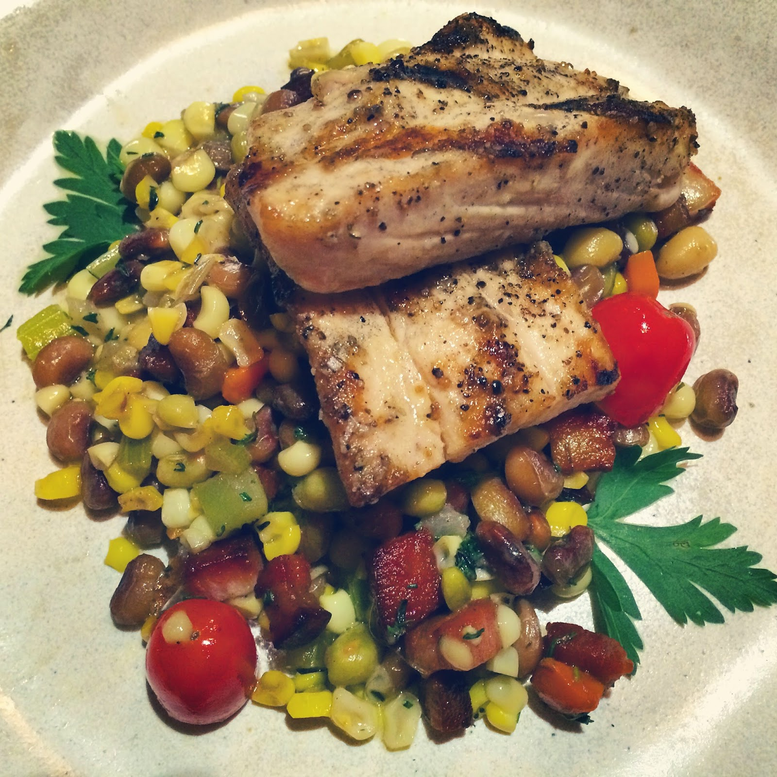 Fresh Gulf Wahoo served over a Summer Succotash with Sweet Corn, Field Peas, Cherry Tomatoes, Bacon Lardons, and Fresh Herbs