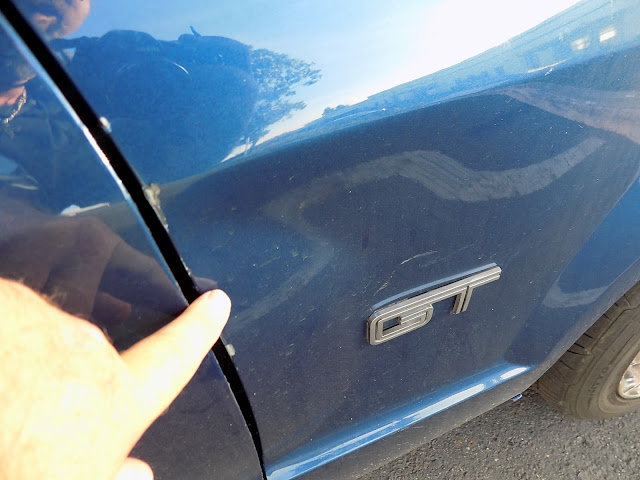 Close up of fender damage on 2006 Mustang GT at Almost Everything Auto Body.