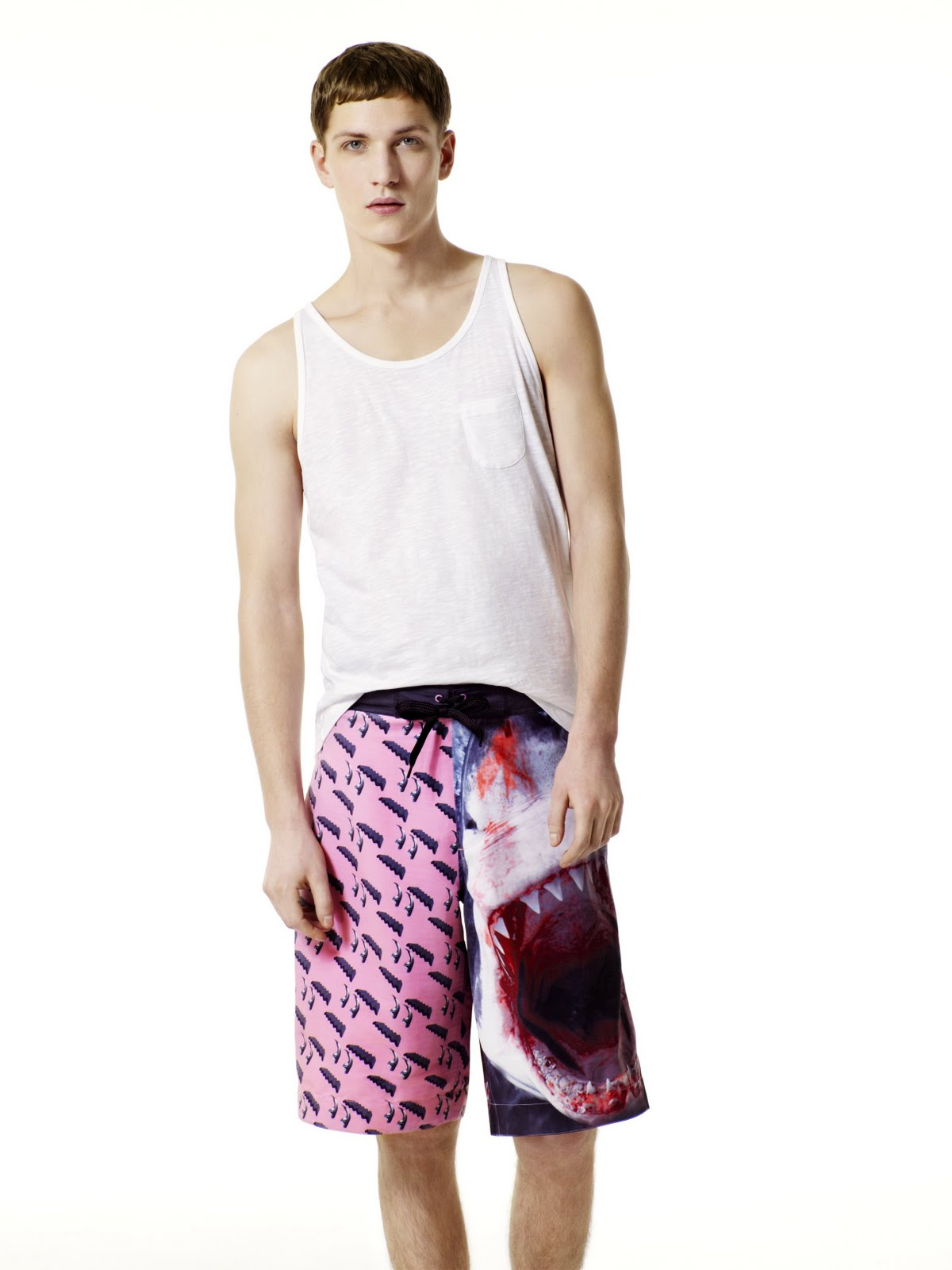 93f5ecebe2 Her short is this boyish knee length with one leg block coloured in pink and  the other leg featuring a photographic print of a shark.