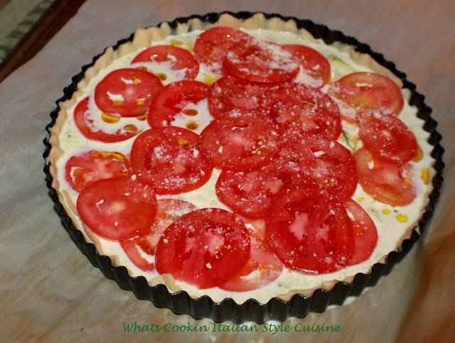 this is a pastry crust tart like quiche filled and baked with mozzarella cheese, zucchini shredded and sliced tomatoes in a rich egg filling into the crust and baked