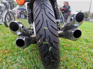 Rear view of motorcycle shows four mufflers.