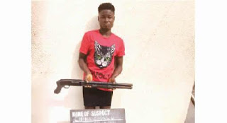 Slay Queen caught with loaded pump action gun in Anambra (Photo)