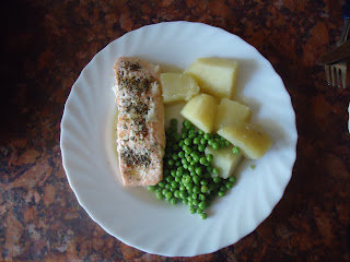 Herby Salmon with potatoes and peas