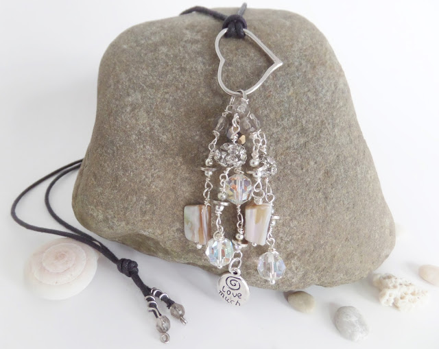 long dangle necklace with shell and crystal