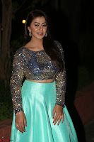 Nikki Galrani in Green Skirt  Top at Marakathamani music launch ~  Exclusive (54).JPG