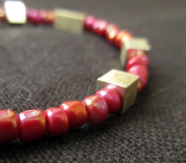 A hot pink chemistry bracelet featuring Avogadro's num