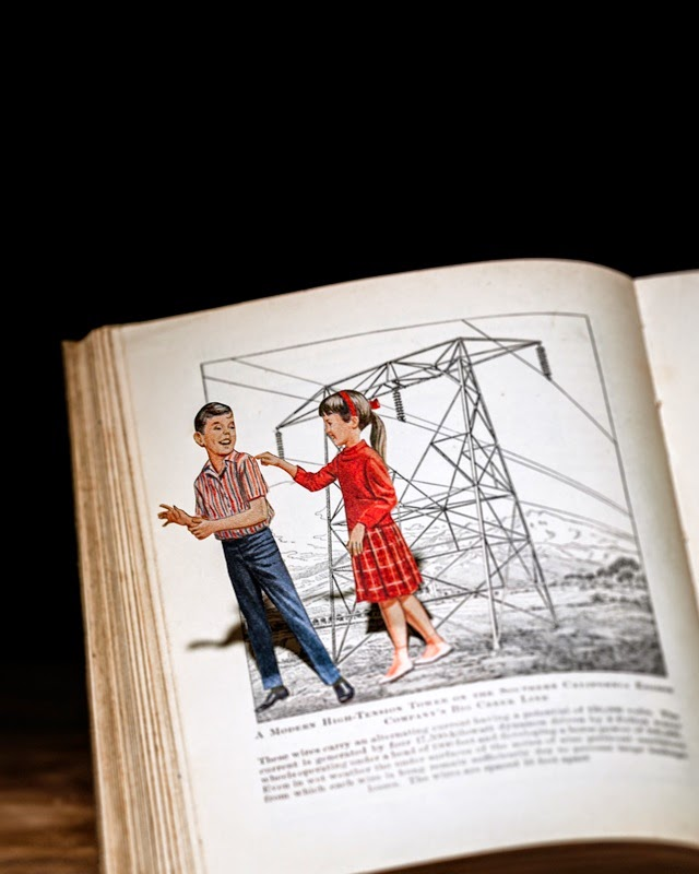 13-Electric-Thomas-Allen-Photographs-of-Cut-out-Book-Art-www-designstack-co