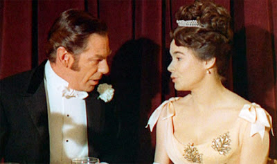 Lord D'Arcy (Michael Gough) wines and dines his new protege Christine (Heather Sears)