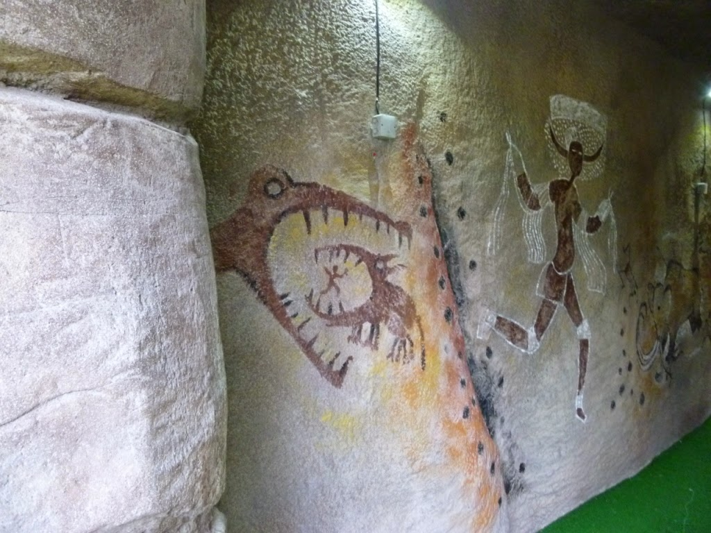 Some ancient alligators on a cave painting at the Jungle Island Adventure Golf course at Horton Park Golf Club in Epsom, Surrey