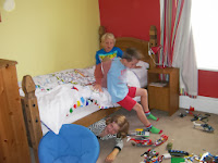 boys and girl playing in bedroom