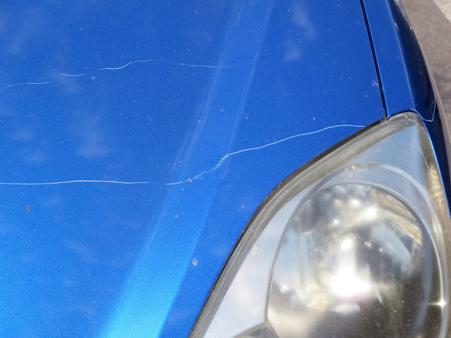 Key scratches on hood of Honda Civic before repairs at Almost Everything Auto Body