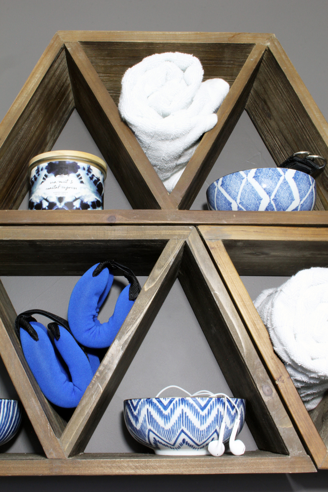 Triangle wood shelves with blue and white porcelain bowls for jewelry