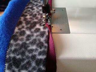 trim edge of patchwork fleece blanket with ribbon Craftrebella