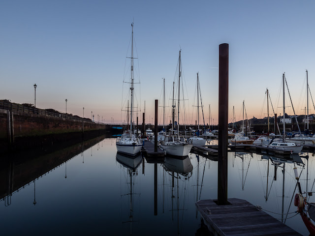 Photo of calm water in the marina at sunrise on Wednesday