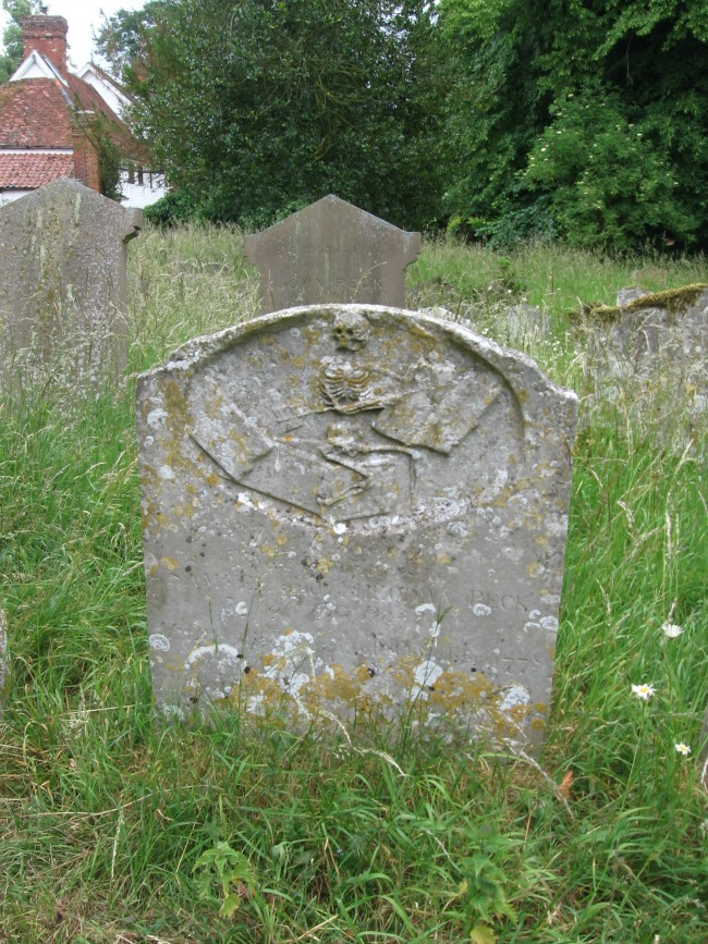 Headstone-worn-just-engraving-of-skeleton-writing-with-quill-in-book-Wetheringsett-Suffolk