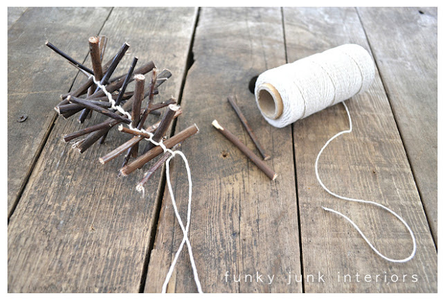 A Christmas garland made from twigs via https://www.funkyjunkinteriors.net/