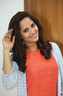 Actress Anasuya Bharadwaj in Orange Short Dress Glam Pics at Winner Movie Press Meet February 2017 (76).JPG
