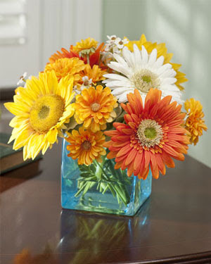 yellow white and orange daisy centerpiece