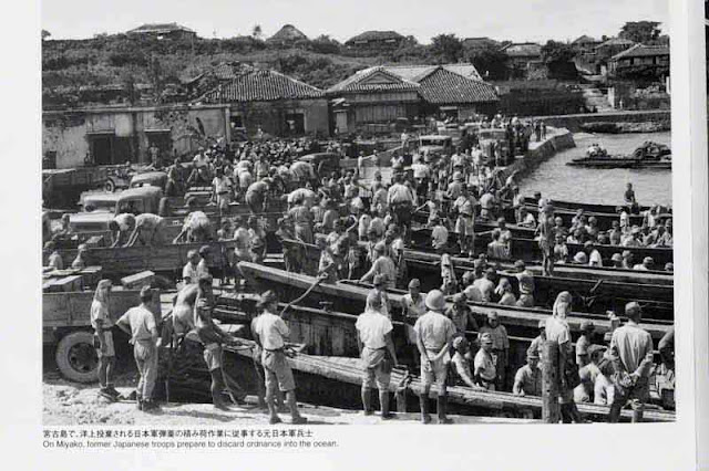 Former Japanese Imperial soldiers discarding war materials, Miyako Island