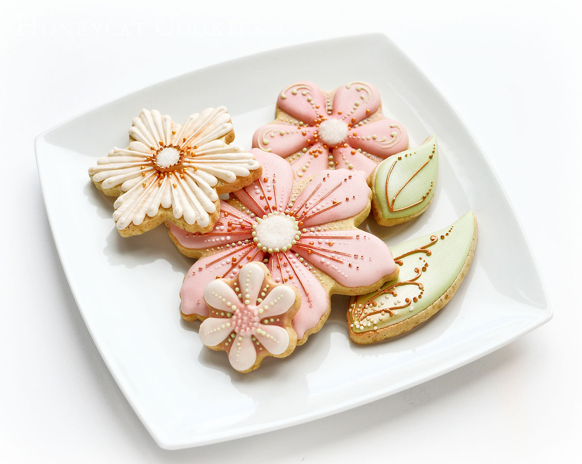 Dish of decorated flower cookies, photo by Honeycat Cookies