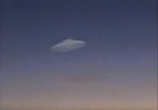 Flying saucer in the sky