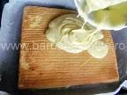 Prajitura cu portocale preparare reteta - acoperim cu crema