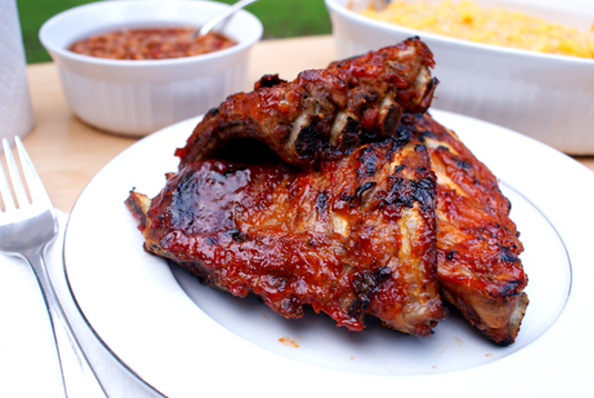 Oven Baked BBQ Baby Back Ribs are mouth-watering, tangy, juicy, tender and perfectly portioned!