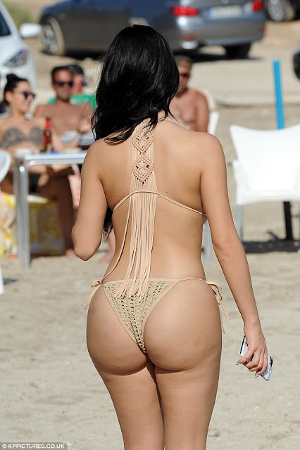 Demi Rose in a tiny bikini on a beach in Ibiza