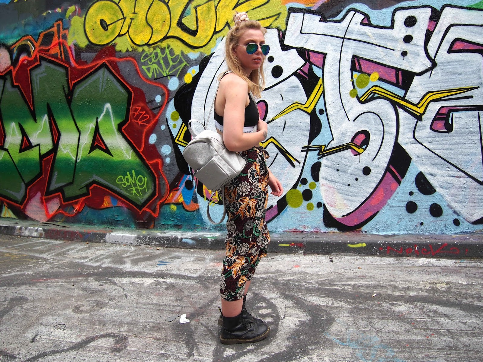 street art ootd, festival grunge outfit, comfy patterned casual trousers, calvin klein bralette, dr martens, reflective mirrored aviator sunglasses, choker, mini silver backpack 2