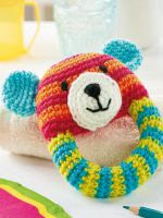http://www.topcrochetpatterns.com/free-crochet-patterns/teddy-bear-rattle