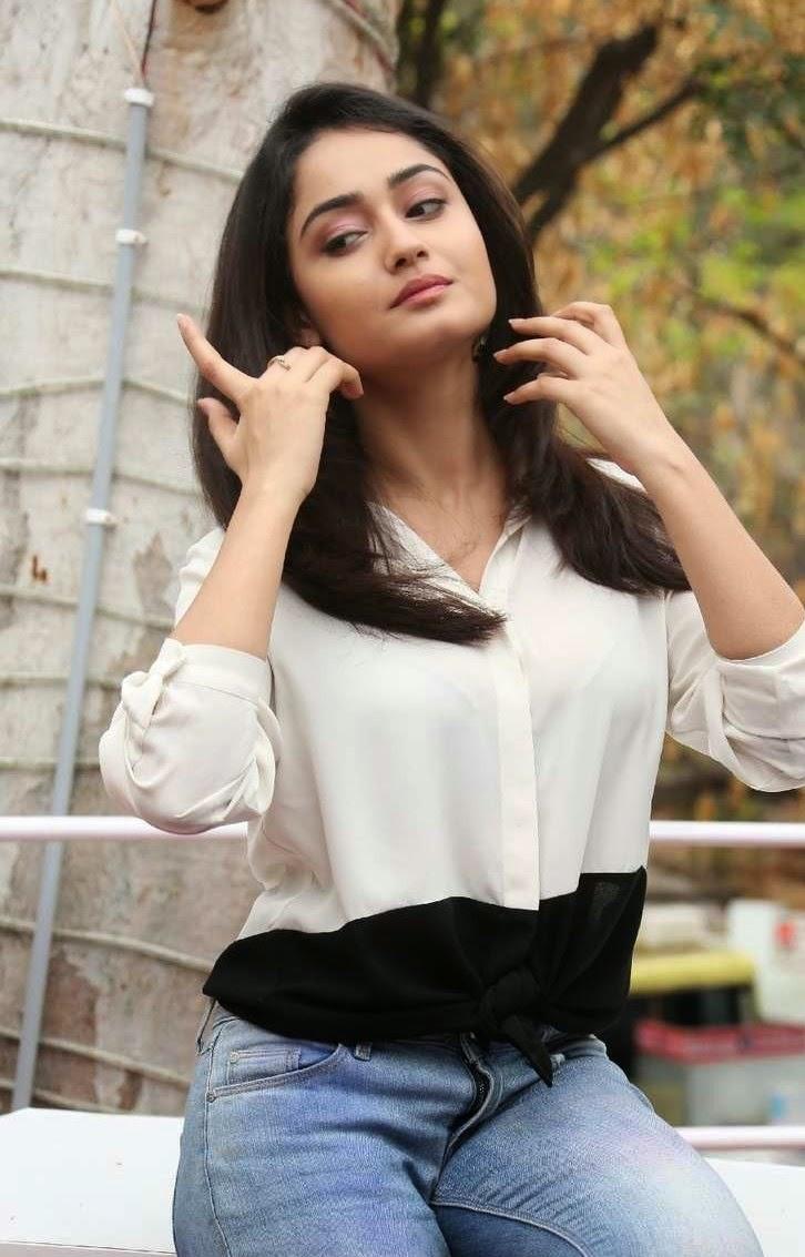 Glamorous Bengali Girl Tridha Choudhury Long Hair Photos In White Dress