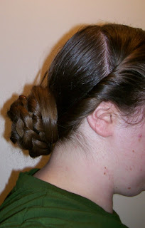 Basic 1850s/1860s hairdo, side view.