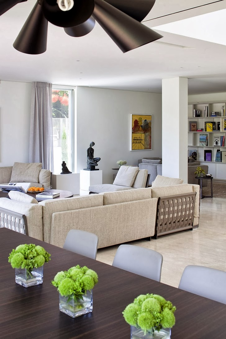 Living room and dining room in Modern family home by Domb Architecture