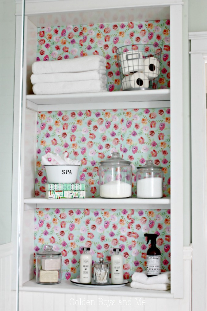 Vintage cottage style accessories on built-in shelves in bathroom for storage - www.goldenboysandme.com