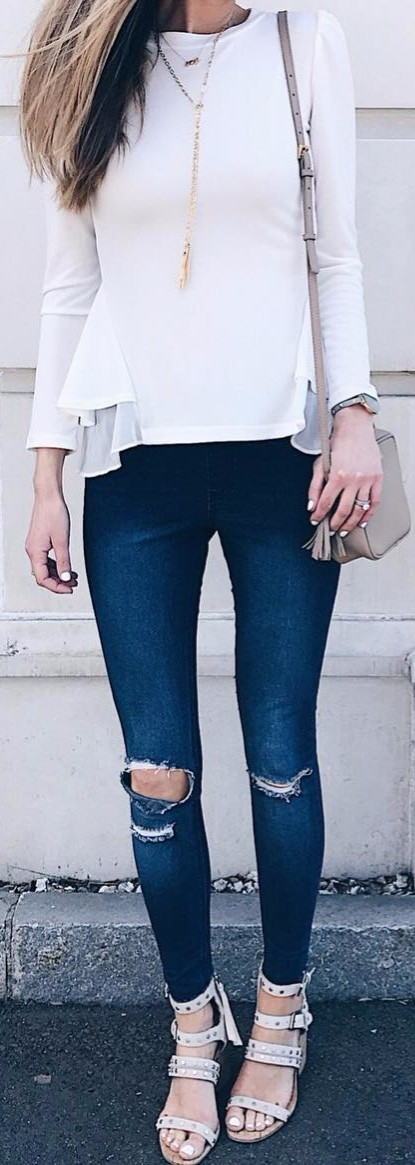 Cool way to wear rips with a white blouse