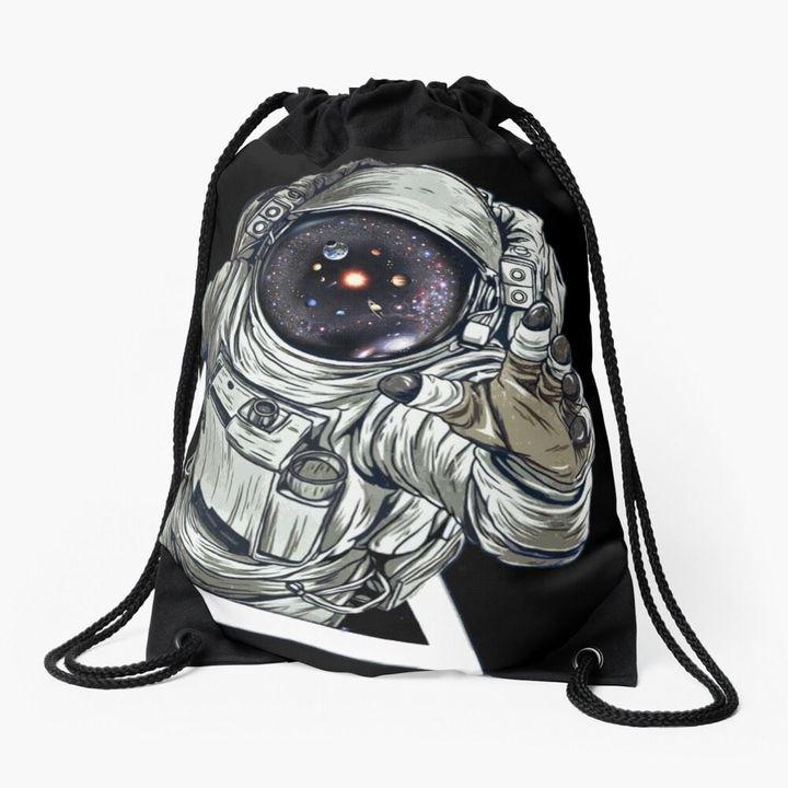 Astronaut touching the Universe drawstring bag