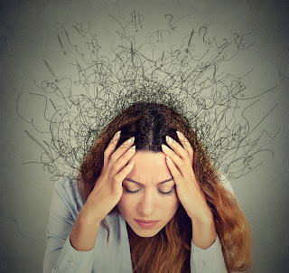 Woman with anxiety shown with a bunch of random scribbly symbols coming out of her head.