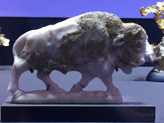Bison. Carved by Gerhard Becker. Gold in quartz matrix. American Museum of Natural History
