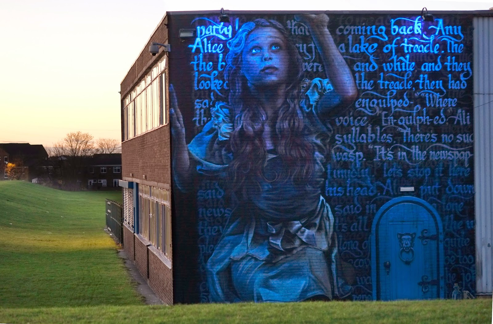 """Irony just finished working a collaboration with Frank Styles who added the calligraphy to the piece which depicts Alice from the classic story """"Alice in Wonderland""""."""