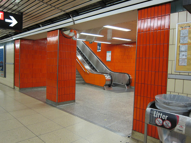 Orange stairwell at St Clair station
