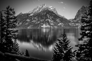 Cramer Imaging's quality black and white landscape photograph of Jenny Lake reflecting the mountains in Grand Teton National Park Wyoming