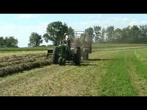 Tractor: Baling hay with a John Deere 630 tractor and 336 baler
