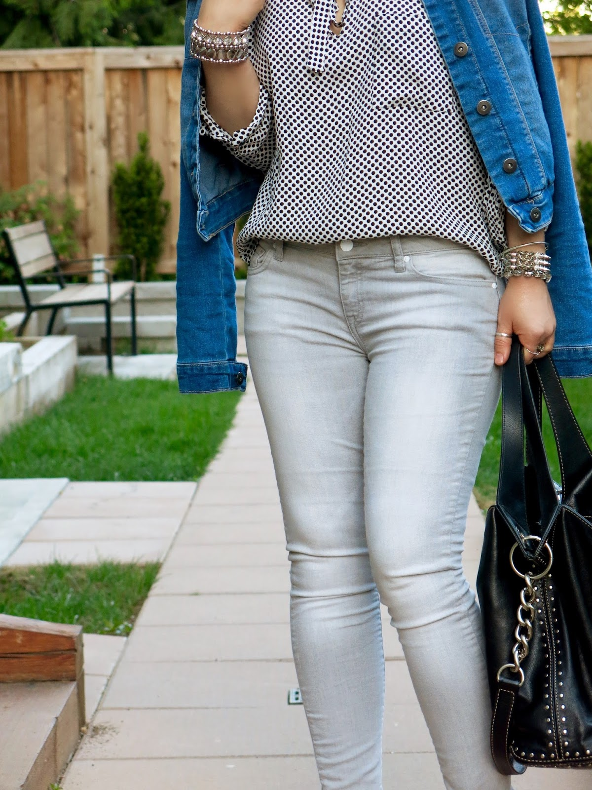 grey skinny jeans, dotted blouse, denim jacket, MK bag