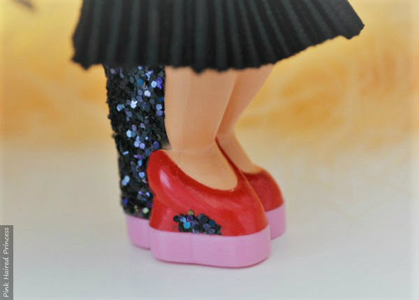 detailed look at Miss Piggy red shoes on character heel with glitter detail