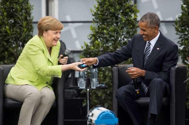 Obama gets rock-star welcome in Berlin, praises Merkel